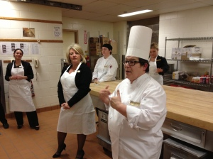 Executive Chef Donna instructs cupcake soldiers on battle tactics